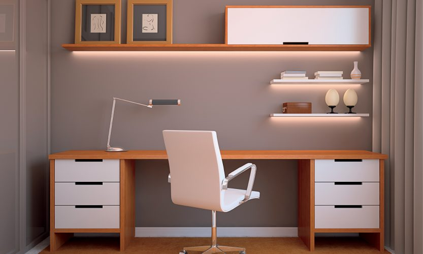 Linear LED Illuminates a desk area with caramel brown wood and grey walls
